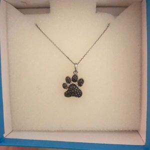 Piercing Pagoda dog paw necklace, never worn!